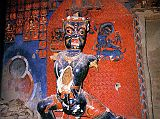Immediately to the right of the door of the White Temple at Tsaparang in the old Guge Kingdom in Western Tibet is a 5m-high guardian figure, blue Vajrapani (Tib. Chana Dorje). The significantly elongated torsos, a typical Guge trademark, have been broken open, exposing the straw. This has since been closed with what looks like white plaster. To the left of Vajrapani is an empty pedestal that used to contain a statue of Tara. Photo - Weyer/Aschoff: Tsaparang, Tibets Grosses Geheimnis.